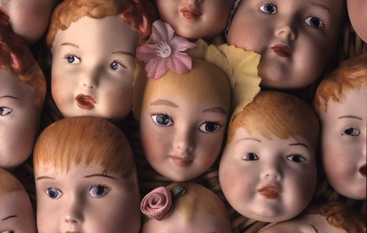 Close up of the dolls faces