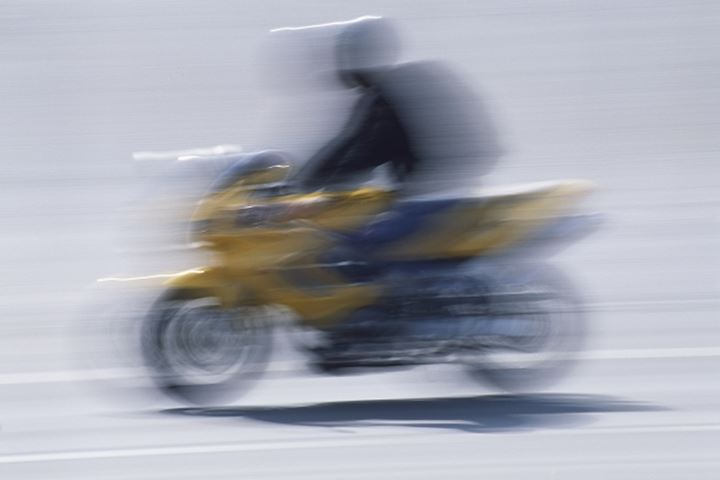 Blurred motion of a person riding the motor bike