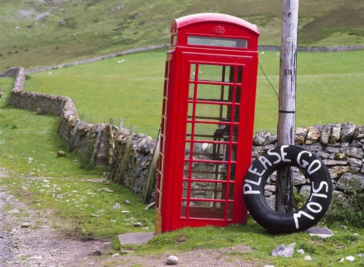 Telephone booth on a landscape