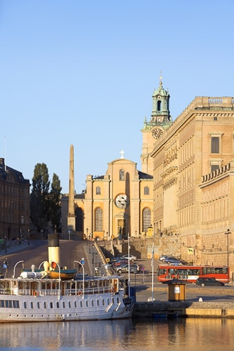 A sight seeing boat by the Royal Palace in Stockholm, Sweden