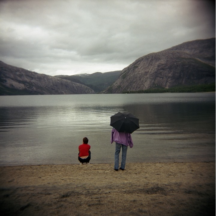 Rear view of two people near the sea, Norway, Virginia