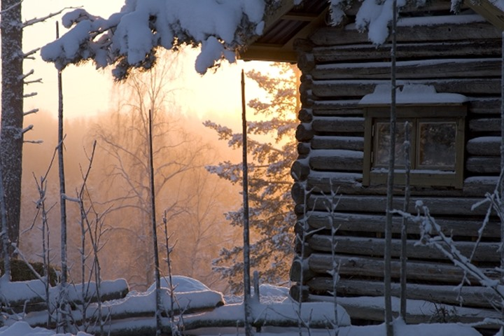Log cabin covered with snow, Sweden