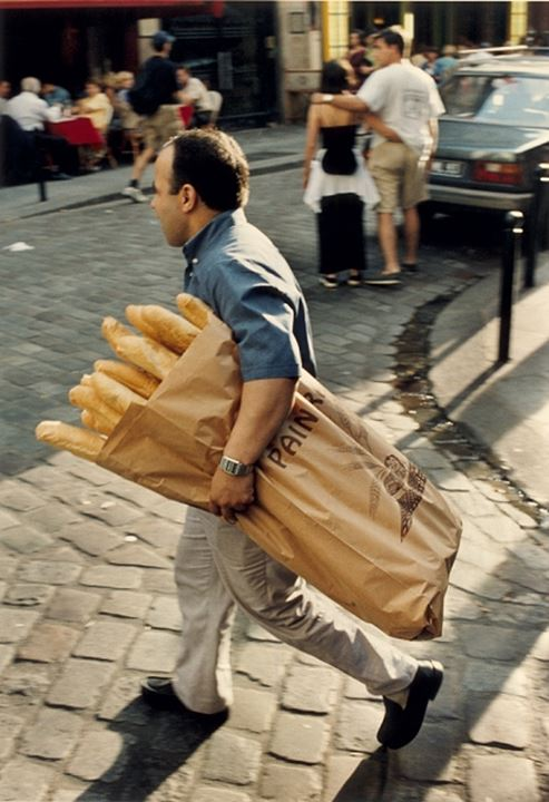 A person carrying food in the bag