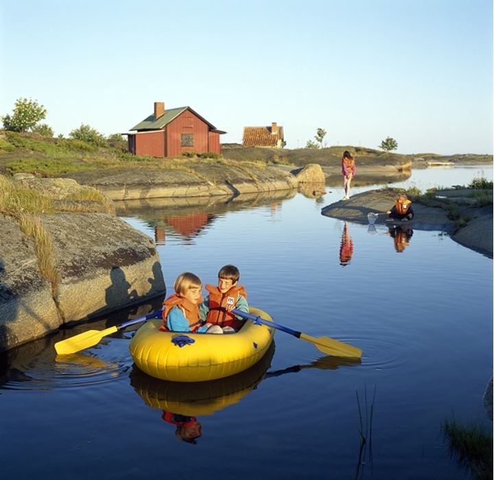 Boy and a girl in an inflatable raft