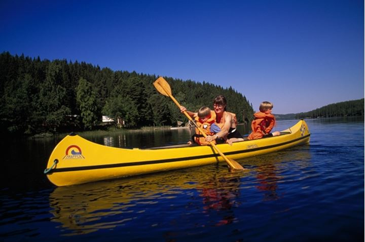 A woman boating with kids