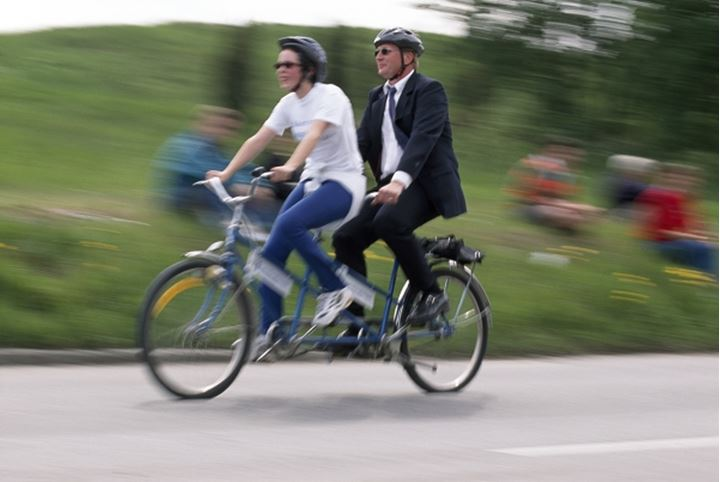 People riding tandembicycle on the road