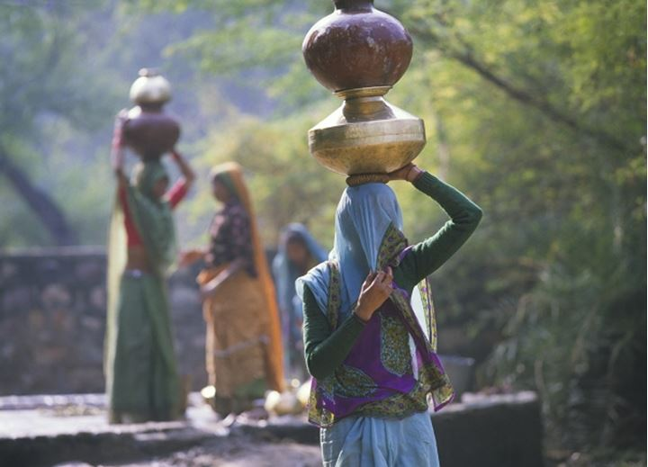 Indian woman carrying waterpots