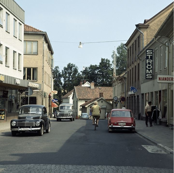 A street with cars and buildings
