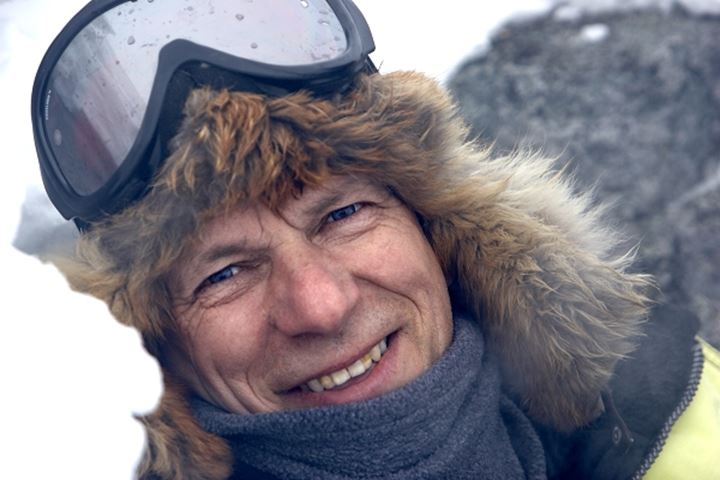 Close-up of an ice climber looking at the camera