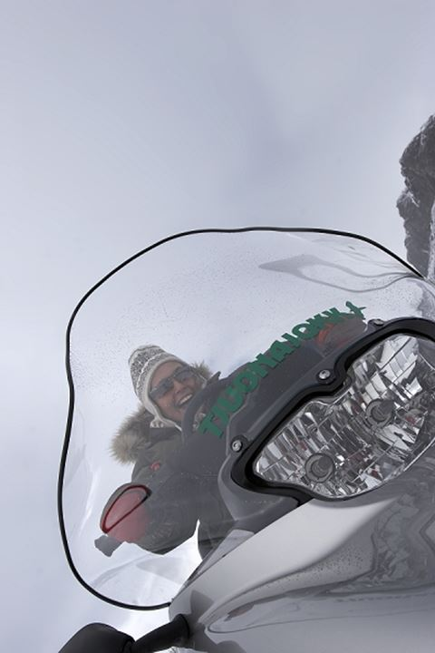 Low angle view of a woman driving snowmobile