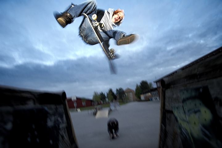 Low angle view of a skateboarder in action