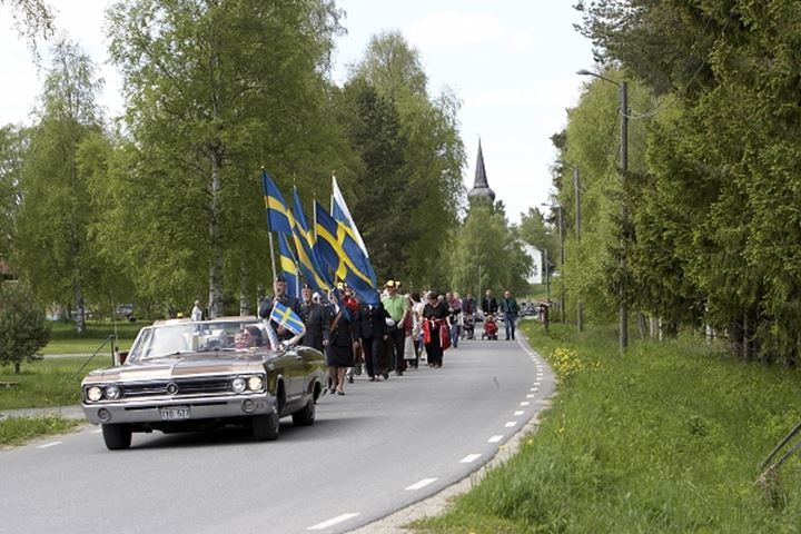 Crowd at a road march on national day of Sweden