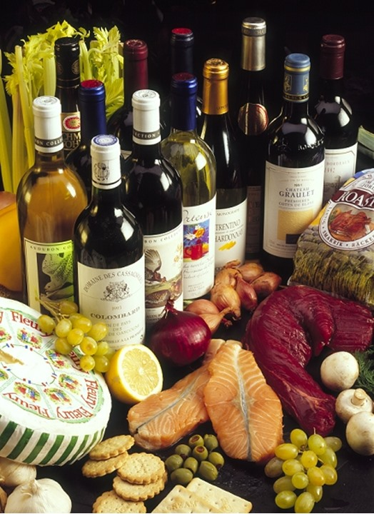 Studio shot of wine bottles with fruits and vegetables