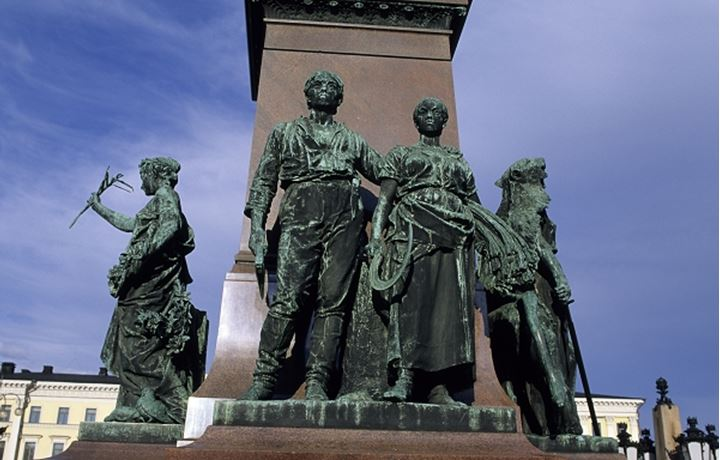 Standing statues of man and woman in Finland, Europe