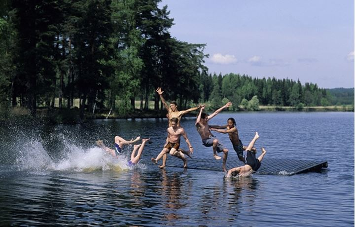 Group of children enjoying and jumping into water