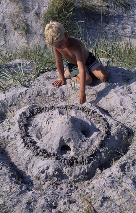 A boy making sand castle