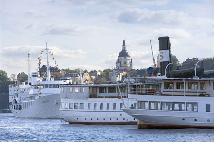 Cruise ship and steam boats docked at a harbor, Old town, Stockholm, Sweden