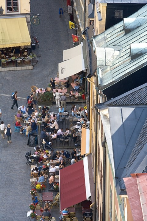 High angle view of a group of people at a sidewalk cafe, Old Town, Stockholm, Sweden