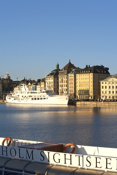 Passenger ship at a port in front of a city, Gamla Stan, Stockholm, Sweden