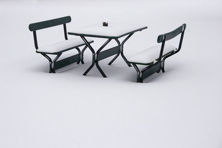 Snow covered benches and a table