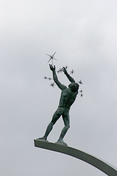 Statue of a nude person with stars