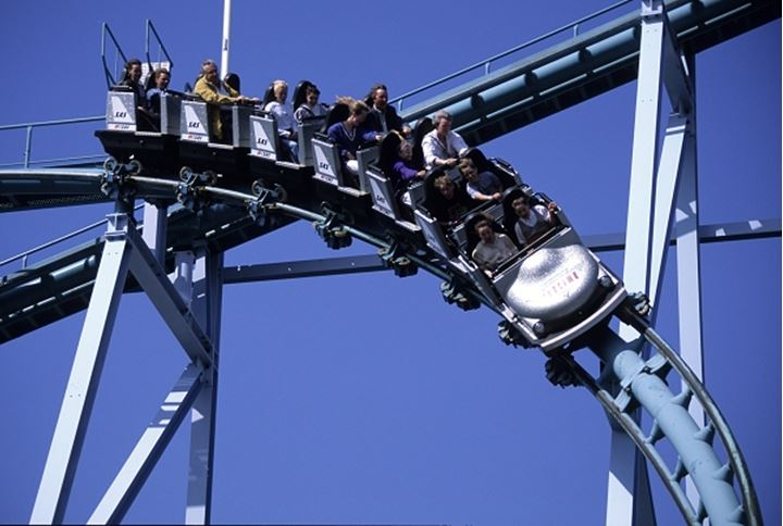 People riding in the roller coaster