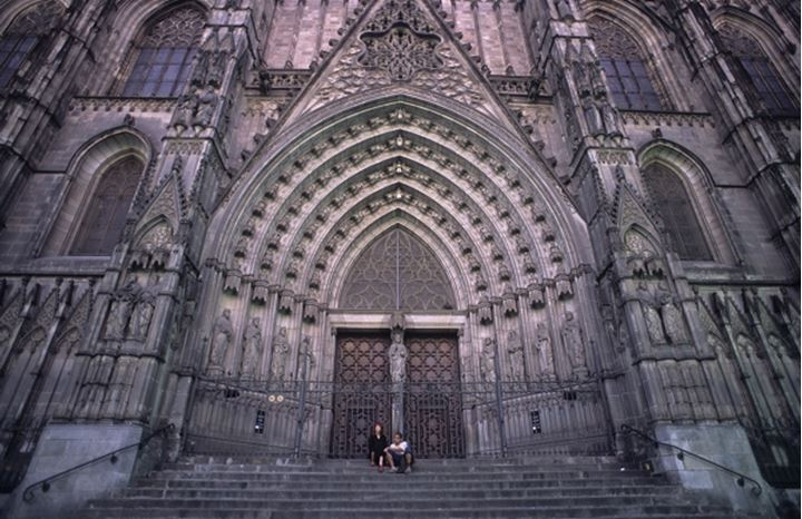 People sitting at the front of church in Barcelona, Spain