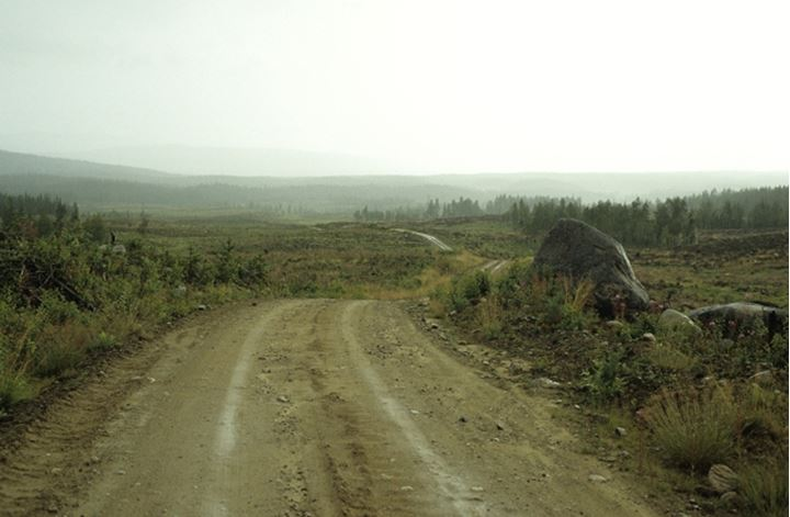 View of rural road up to mountains