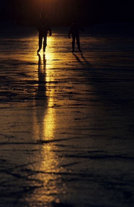 Silhouette of two people at night