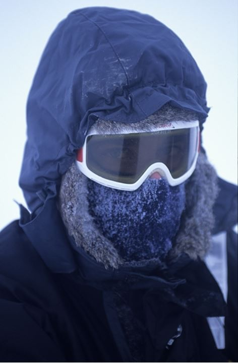 Closeup of a person wearing goggles and mask