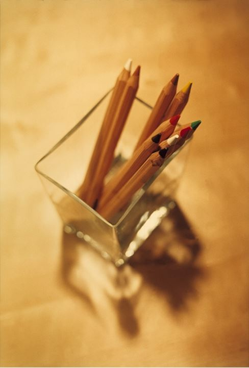 Overhead view of sharped colour pencils in the stand