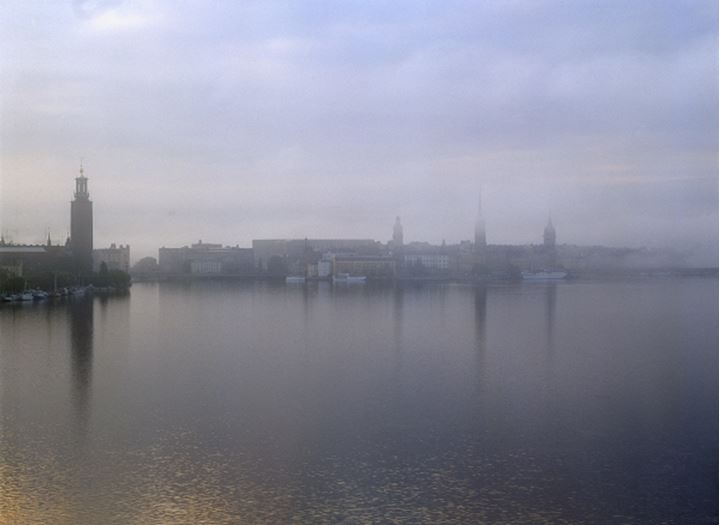 Buildings and towers with fog near the sea