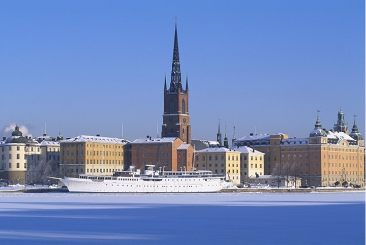 Riddarholmen church with buildings and ship in Stockholm, Sweden