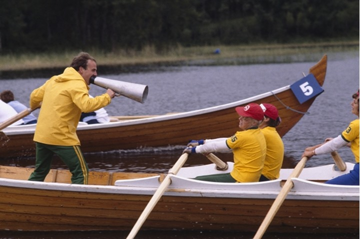 Boatrace person with a megaphone on a rowboat