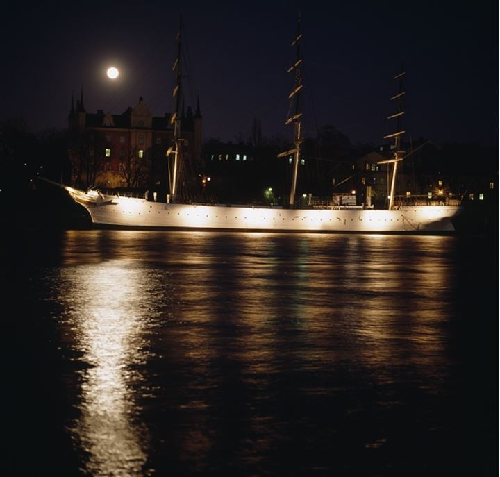 Ship lit up in the sea