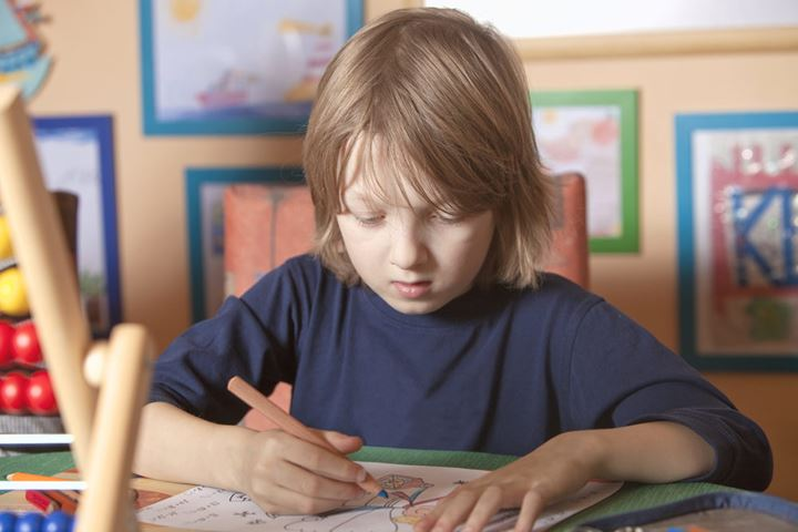 Boy Working on his Homework at Home
