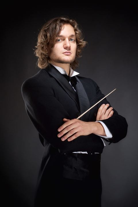 Portrait of a Young Conductor Holding a  Baton.