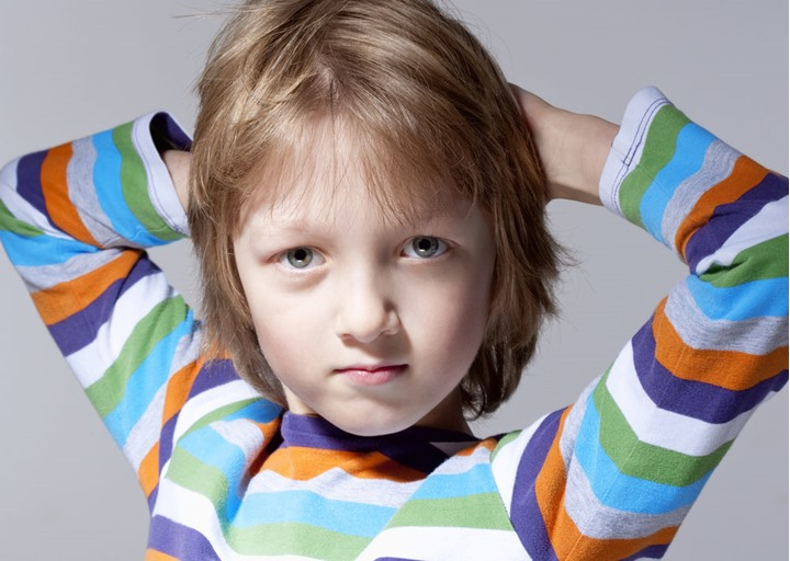 Portrait of a Boy with Blond Hair - Isolated on Gray