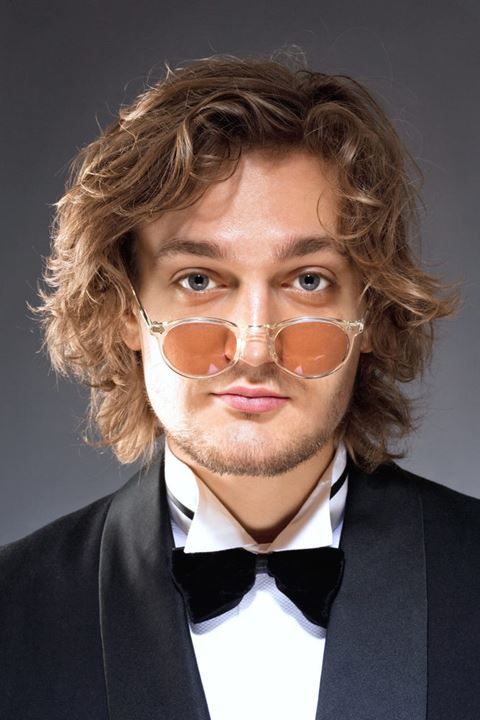 Portrait of a Young Man with Glasses in Tuxedo