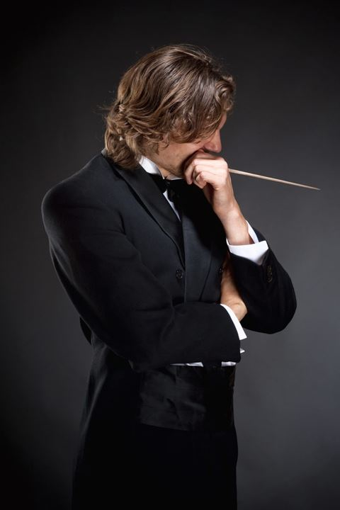 Young Conductor Holding a  Baton Thinking