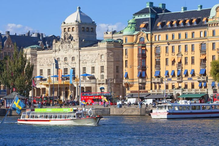 Sweden, Stockholm - Boat traffic at Nybroviken and Royal Dramatic Theatre.