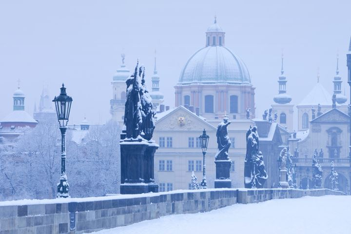 Prague - Charles Bridge and spires of The Old Town in winter.