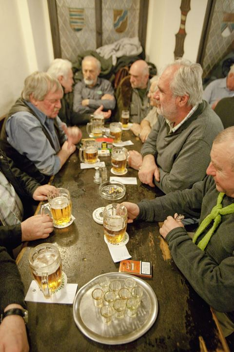 Prague - friends in a traditional Czech pub drinking beer.