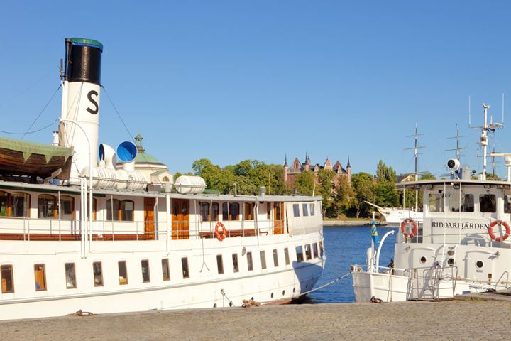 Sweden, Stockholm - Steamboats moored along the quayside of The Old Town.