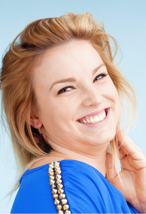Portrait of Young Woman with Blond Hair Smiling  - Isolated on Blue