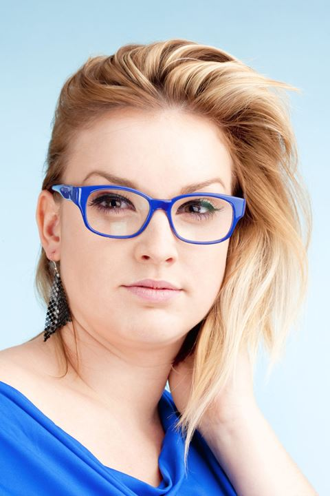 Portrait of Young Woman with Blond Hair and glasses  - Isolated on Blue
