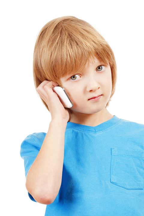 Portrait of a Boy Talking on Mobile Phone - Isolated on White