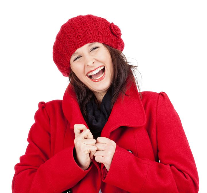 Young Woman in Red Coat and Cap Laughing - Isolated on White