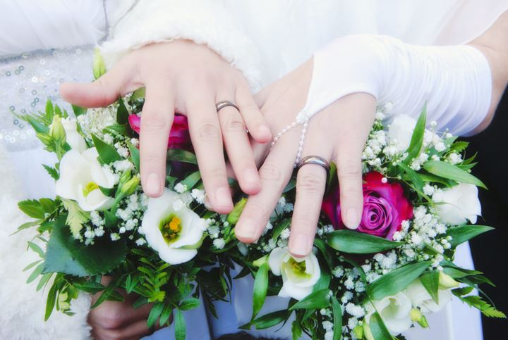 Lesbian Wedding - Newlywed Women Showing their Rings
