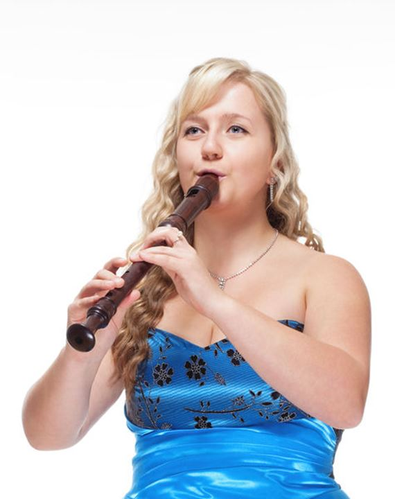 Female Musician in Blue Dress Playing Flute - Isolated on White